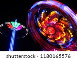 colorful spinning wheel at...   Shutterstock . vector #1180165576