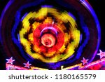 colorful spinning wheel at...   Shutterstock . vector #1180165579