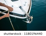 man s hand with boat rope.... | Shutterstock . vector #1180196440
