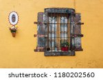 colors and windows in mexico... | Shutterstock . vector #1180202560