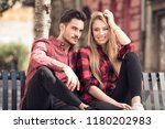 smiling couple in love dating... | Shutterstock . vector #1180202983