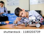 little boy in robotics school... | Shutterstock . vector #1180203739