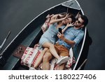 young and playful couple. top... | Shutterstock . vector #1180227406
