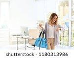 young beautiful businesswoman... | Shutterstock . vector #1180313986