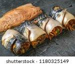 four rolls of mackerel with... | Shutterstock . vector #1180325149