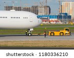 passenger plane is towed at the ... | Shutterstock . vector #1180336210