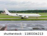 widebody passenger airplane.... | Shutterstock . vector #1180336213
