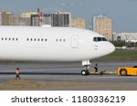 passenger plane is towed at the ... | Shutterstock . vector #1180336219