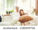 portrait of happy asian married ...   Shutterstock . vector #1180359736