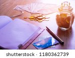 note book with coin   dollar ... | Shutterstock . vector #1180362739
