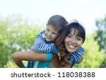 happy mother with boy   against ... | Shutterstock . vector #118038388