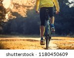 happy bearded man cyclist rides ... | Shutterstock . vector #1180450609
