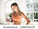 healthy happy woman with modern ...   Shutterstock . vector #1180456129