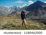 photographer in mountains altai | Shutterstock . vector #1180462000