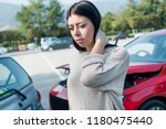 injured woman feeling neck pain ... | Shutterstock . vector #1180475440