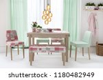 dining table with curtains and... | Shutterstock . vector #1180482949