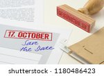 a red stamp on a document  ... | Shutterstock . vector #1180486423