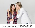 two young women exchanging news.... | Shutterstock . vector #1180567636