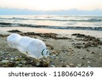 a plastic bottle lies on the... | Shutterstock . vector #1180604269