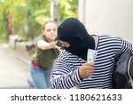 robber snatching money and bag...   Shutterstock . vector #1180621633