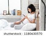 asian girl she is relaxing  she ... | Shutterstock . vector #1180630570