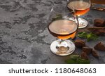 two portions of brandy  served...   Shutterstock . vector #1180648063