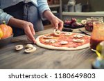 fresh pizza with tomato and... | Shutterstock . vector #1180649803