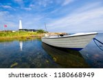fishing boat moored on the... | Shutterstock . vector #1180668949