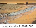 sweetheart walking on the beech ...   Shutterstock . vector #1180671580