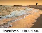 sweetheart walking on the beech ...   Shutterstock . vector #1180671586