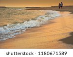 sweetheart walking on the beech ...   Shutterstock . vector #1180671589