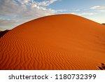 sand dune in sossusvlei. namib... | Shutterstock . vector #1180732399