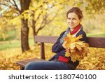 young beautiful woman in autumn ... | Shutterstock . vector #1180740100