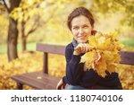 young beautiful woman in autumn ... | Shutterstock . vector #1180740106