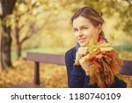 young beautiful woman in autumn ... | Shutterstock . vector #1180740109