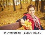 young beautiful woman in autumn ... | Shutterstock . vector #1180740160