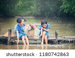 two gril children sitting and... | Shutterstock . vector #1180742863