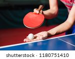 a young man is playing ping... | Shutterstock . vector #1180751410