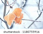 dead leafs covered by snow.... | Shutterstock . vector #1180755916