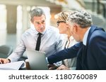three mature business... | Shutterstock . vector #1180760089