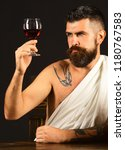 god of wine with concentrated... | Shutterstock . vector #1180767583