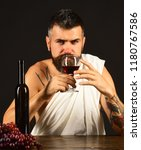 sommelier smells drink. god... | Shutterstock . vector #1180767586