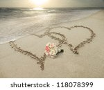two hearts drawn in sand at the ... | Shutterstock . vector #118078399
