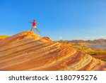 young hiking girl jumping at... | Shutterstock . vector #1180795276
