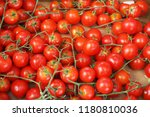 tomatoes cherry in the market | Shutterstock . vector #1180810036