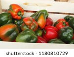red and green peppers in the... | Shutterstock . vector #1180810729