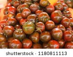 black tomatoes in the market | Shutterstock . vector #1180811113