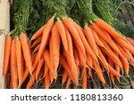 bright carrots in the market | Shutterstock . vector #1180813360
