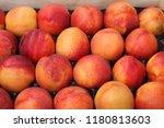 bright nectarines in the market | Shutterstock . vector #1180813603