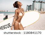 fancy young girl on the beach... | Shutterstock . vector #1180841170